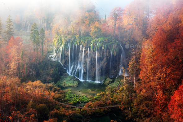 Aerial view on amazing foggy waterfall in Plitvice lakes - Stock Photo - Images