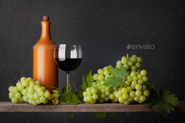 White grape, bottle and red wine glass - Stock Photo - Images