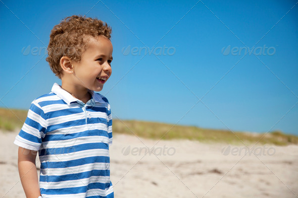 Adorable Kid Outdoors Looking Happy - Stock Photo - Images