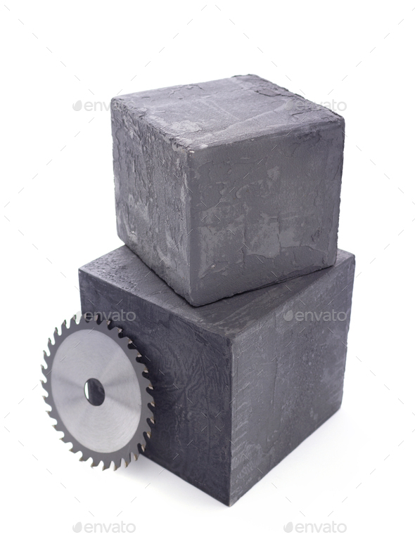 Circular saw blade at concrete cube or cement block isolated at white background - Stock Photo - Images
