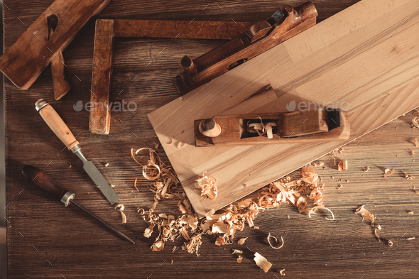 Plane jointer carpenter or joiner tool and wood shavings. Woodworking tools on wooden table - Stock Photo - Images