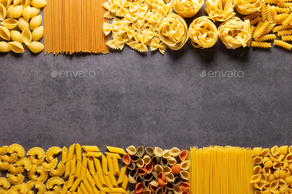 Raw pasta assortment at stone tabletop. Pasta collection food at table background - Stock Photo - Images
