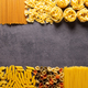 Raw pasta assortment at stone tabletop. Pasta collection food at table background - PhotoDune Item for Sale
