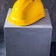 Helmet or hardhat on concrete cube or cement block background texture. Construction concept - PhotoDune Item for Sale