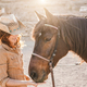 Young farmer woman playing with her horse at farm ranch - PhotoDune Item for Sale