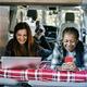 Multiracial women friends having fun camping inside camper van - PhotoDune Item for Sale