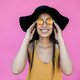 Hipster african girl smiling at camera outdoors with pink background - Focus on face - PhotoDune Item for Sale