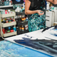 Senior woman painting inside her atelier studio at home - Focus on left hand - PhotoDune Item for Sale