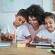 Teacher using tablet with children in kindergarten school - Focus on girl face - PhotoDune Item for Sale