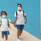 Children with face mask going back to school during coronavirus outbreak - Focus on boy face - PhotoDune Item for Sale
