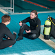 Divers in scuba gear leisures after dive lesson - PhotoDune Item for Sale