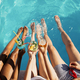 Friends drink beverages at the pool, top view - PhotoDune Item for Sale