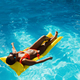 Sexy woman swims on mattress in the pool, top view - PhotoDune Item for Sale