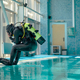 Male diver in scuba gear jumps into the pool - PhotoDune Item for Sale