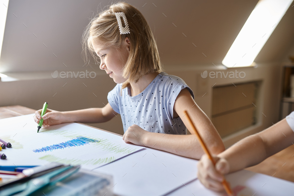 Little girl drawing with markers, kid in workshop - Stock Photo - Images