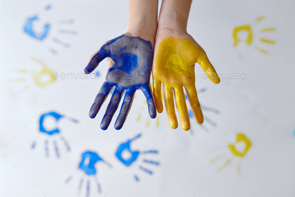 Girl hands painted with gouache, kid in workshop - Stock Photo - Images