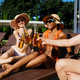 Friends clink bottles with beer near the pool - PhotoDune Item for Sale