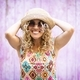 Portrait of beautiful enthusiastic young woman in sunglasses and straw hat posing outdoors - PhotoDune Item for Sale
