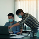 colleague stood at the office and analyzed corporate data while wearing a face mask - PhotoDune Item for Sale