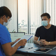 Doctors are explaining the treatment of a patient's illness while wearing a mask during - PhotoDune Item for Sale