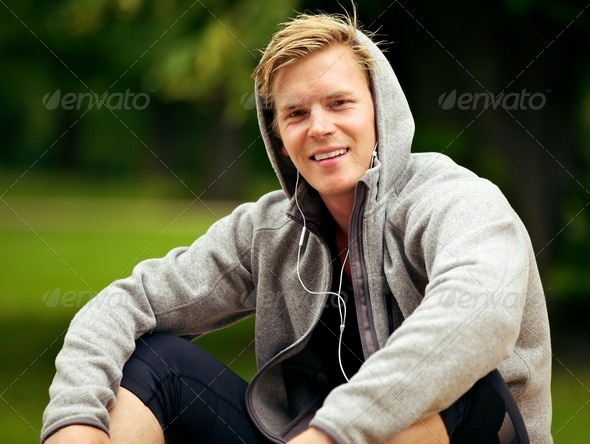 Guy Enjoying His MP3 at the Park - Stock Photo - Images