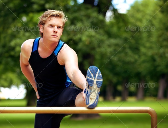 Guy Doing Exercise Routine at the Park - Stock Photo - Images