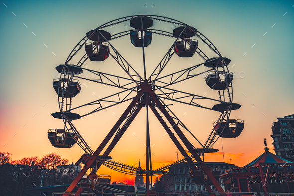 Ferris wheel at sunset - popular park attraction - Stock Photo - Images