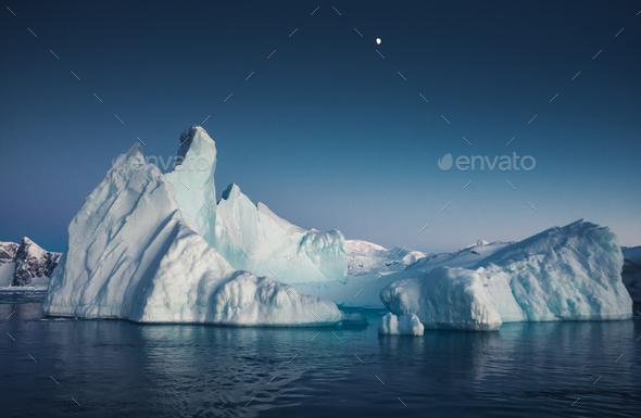 Close-up iceberg next to the Antarctica shoreline - Stock Photo - Images