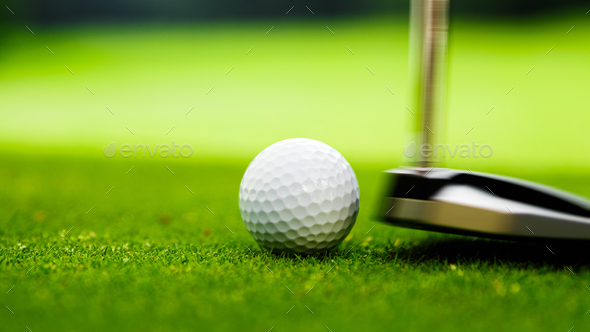 Young golfer playing with putter - Stock Photo - Images