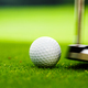 Young golfer playing with putter - PhotoDune Item for Sale