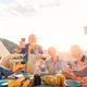 Happy seniors taking a selfie with mobile phone and making a barbecue on the rooftop - PhotoDune Item for Sale