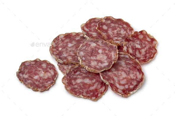 Slices of fresh Rosette de Lyon, a French pork saucisson on white background - Stock Photo - Images
