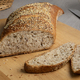 Traditional sourdough bread in a special shape with seeds on a cutting board - PhotoDune Item for Sale