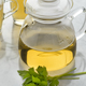 Glass teapot with lovage tea and a fresh twig of lovage - PhotoDune Item for Sale