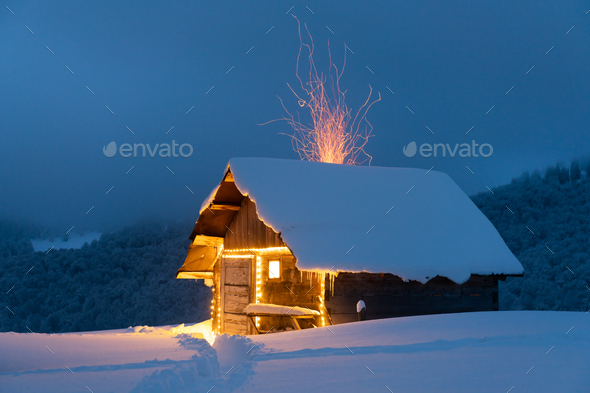 Fantastic landscape with glowing snowy house - Stock Photo - Images