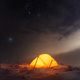Yellow tent lighted from the inside against the backdrop of glowing city lights - PhotoDune Item for Sale