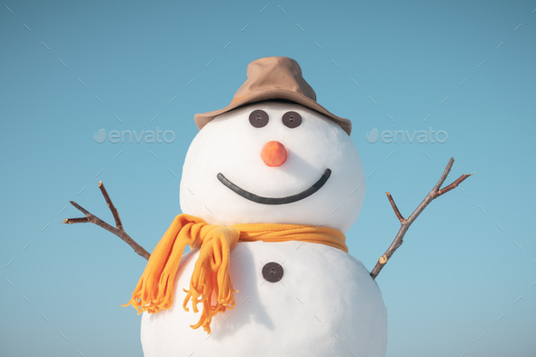Funny snowman in stylish red hat - Stock Photo - Images