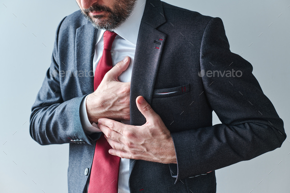 Businessman with cardiovascular problems, adult male entrepreneur having heart-attack - Stock Photo - Images