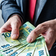 Businessman offering payment in new hundred euro banknotes - PhotoDune Item for Sale