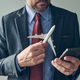 Businessman booking airplane flight ticket online using mobile phone application - PhotoDune Item for Sale