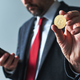 Businessman using mobile smart phone app for Bitcoin mining - PhotoDune Item for Sale