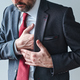 Businessman with cardiovascular problems, adult male entrepreneur having heart-attack - PhotoDune Item for Sale