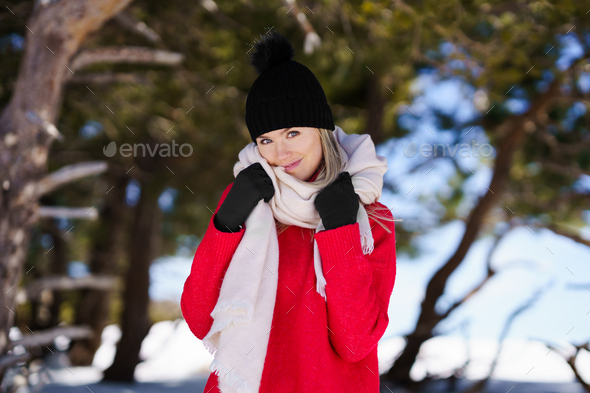 Sweet blonde woman in a snowy forest in the mountains in winter, in Sierra Nevada, Granada, Spain. - Stock Photo - Images