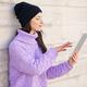 Female student in her twenties using digital tablet outdoors. - PhotoDune Item for Sale