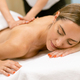 Middle-aged woman having a back massage in a beauty salon. - PhotoDune Item for Sale