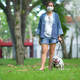 Woman with French bulldog on the lawn. - PhotoDune Item for Sale