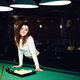 Young curly girl posed near billiard table - PhotoDune Item for Sale