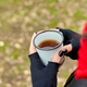 Woman in red hat and scarf, drinking tea from metal cup outdoor - PhotoDune Item for Sale