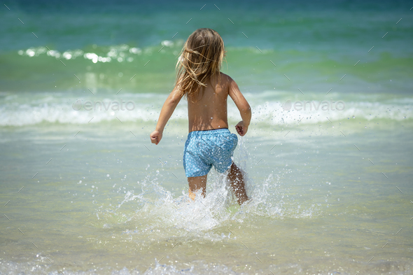Happy Little Boy on the Beach - Stock Photo - Images