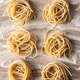 Italian pasta nest. Uncooked spaghetti nest and flour. - PhotoDune Item for Sale
